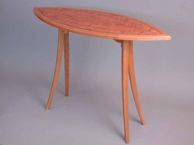 Cherry boat table with curved legs